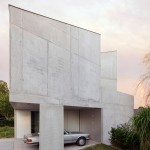 Stark concrete house by ISM Architecten is topped with a glass study