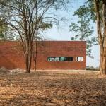 Layers of brick, concrete and glass define private spaces in a Thai home