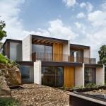 Concrete house in Mexico by Taller Hector Barroso cascades towards a lake