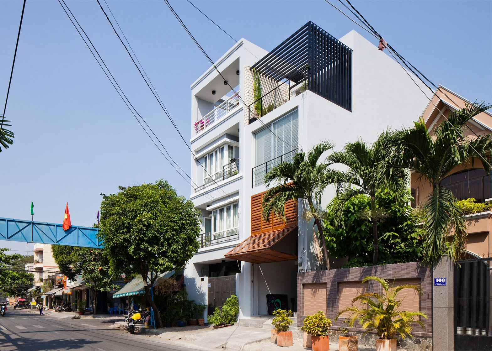 Vietnamese shophouse by MM++ Architects features a facade that folds open