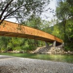 Arching wooden footbridge by DANS Architects connects Slovenian village to mountains