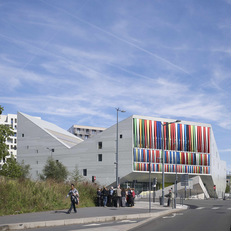 Julien De Smedt's angular concrete youth centre in Lille features a colourful striped wall