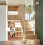 Taiwan apartment renovation by Hao Design includes a new floor with house-shaped doors
