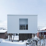 Top-heavy house by Archi LAB designed to minimise snow buildup