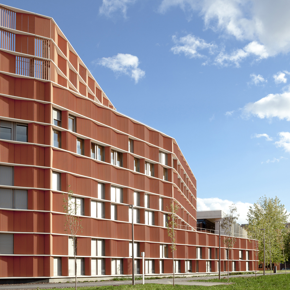Terracotta panels create zigzagging walls for Madrid university building by Estudio Beldarrain