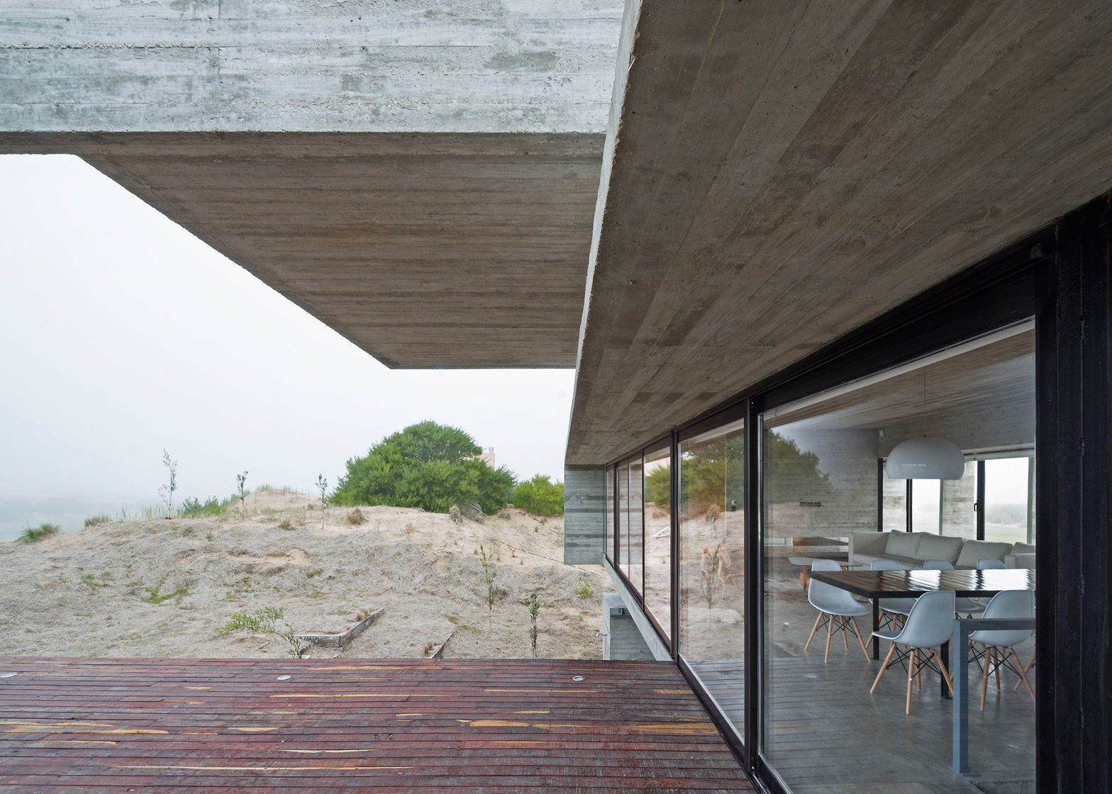 concrete houseluciano kruk stands on seaside golf course
