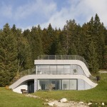French villa designed by Julien De Smedt to look like a bump in the landscape