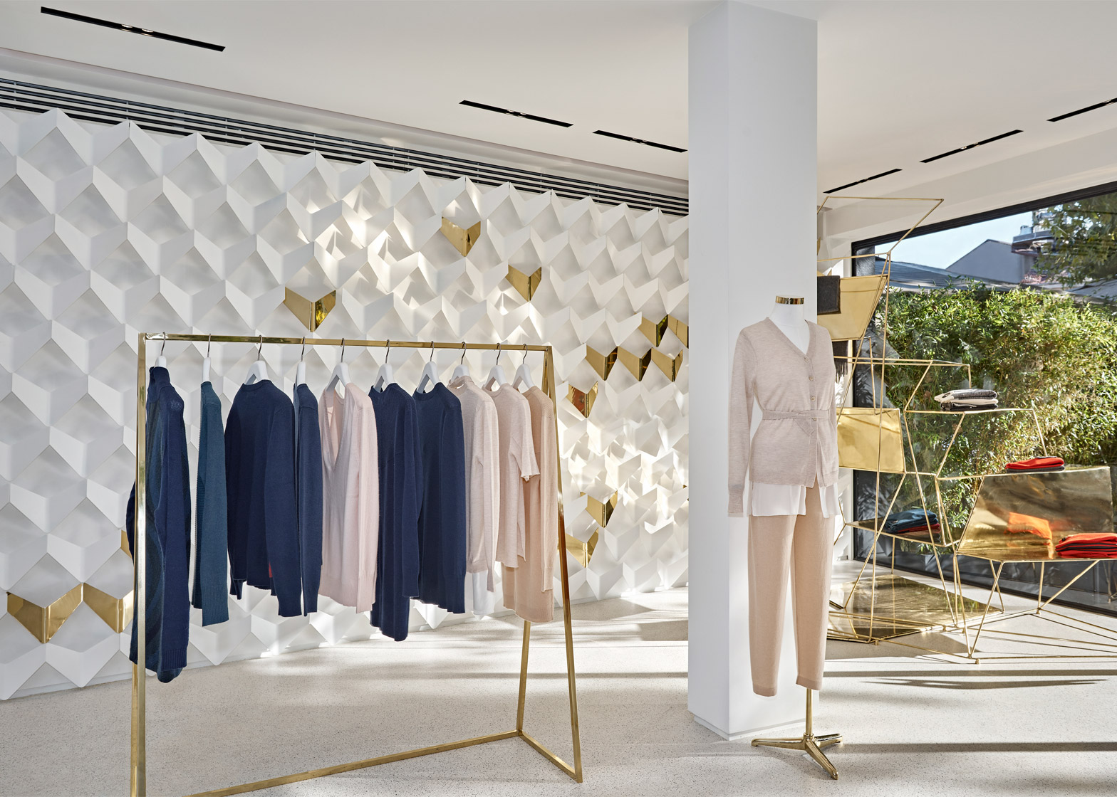 Urastudio creates minimalist clothing boutique in istanbul for Interior designs of boutique shops