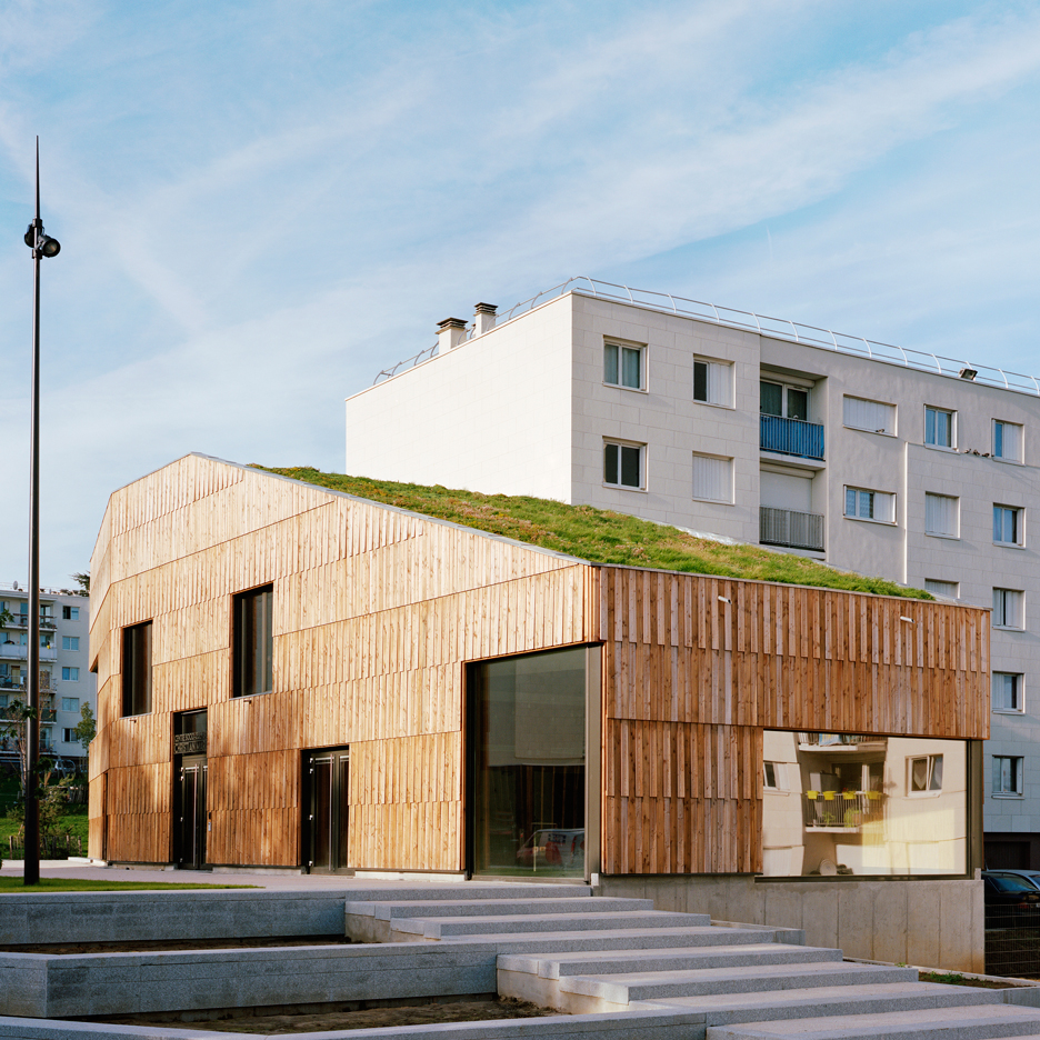 Passivhaus community centre by Guillaume Ramillien Architecture is clad in grass and timber
