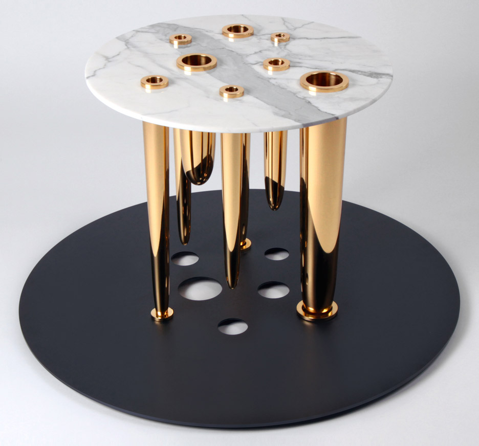 Richard Yasmine's Glory Holes tables has brass dildos for legs - 웹