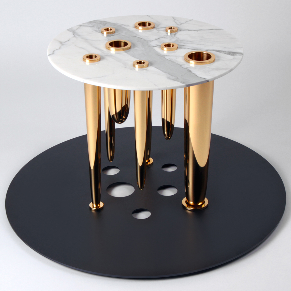 Richard Yasmine's Glory Holes table has brass dildos for legs