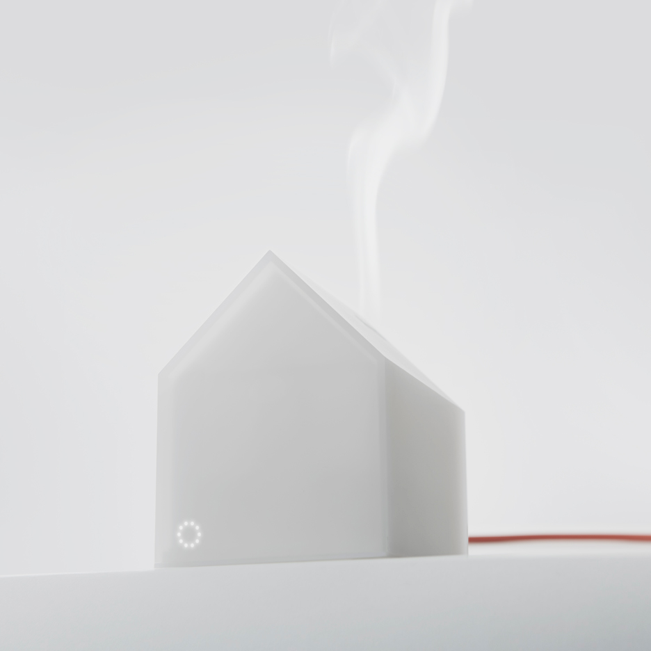 House aroma diffuser resembles a snow-covered cabin