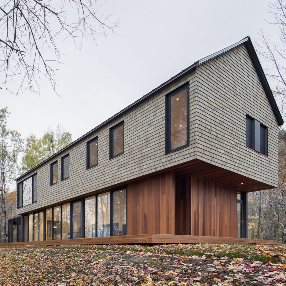 Woodland Quebec home by Bourgeois Lechasseur features a facade of wooden tiles