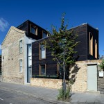 Chris Dyson Architects adds two blackened-wood extensions to a London terraced house