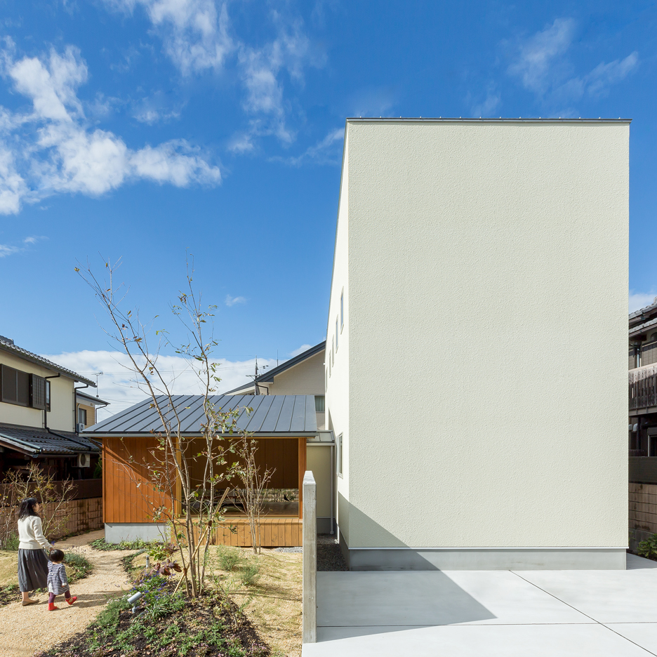 Maibara House by Alts Design Office combines a windowless block and a small garden pavilion