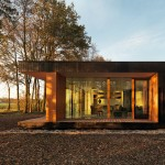 DP6 Architectuurstudio completes glass and timber home in a woodland setting
