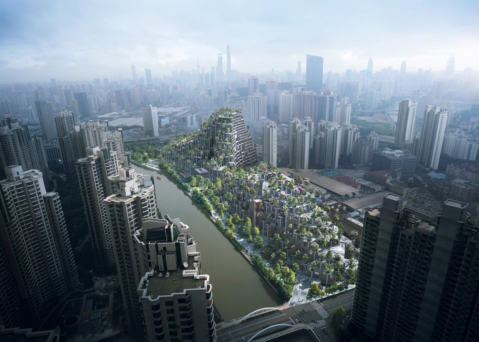 "Drone footage shows Heatherwick Studio's ""tree-covered mountains"" underway in Shanghai"