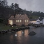 Old Norwegian boathouse overhauled to create glowing wooden summerhouse