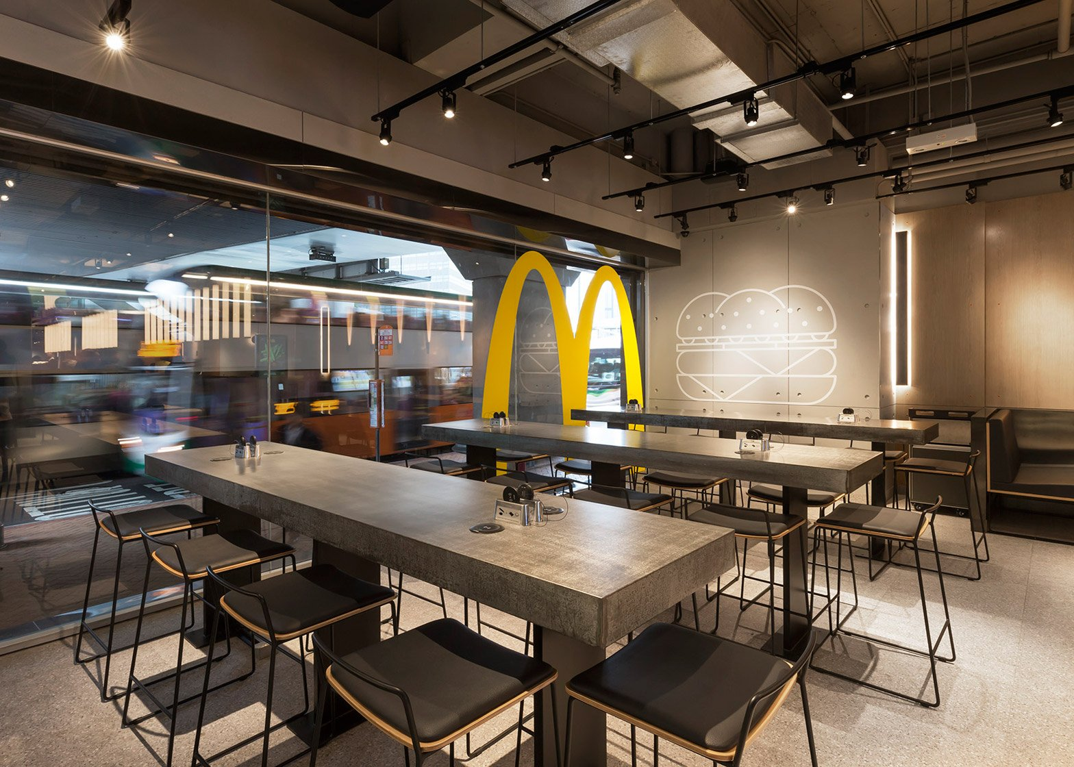 hong kong mcdonald s pilots an experiment in non design rh dezeen com interior design fast food shop interior design fast food outlet