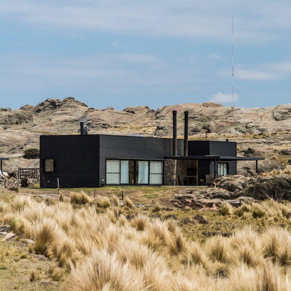 Dark corrugated cladding covers Mariana Palacios' self-designed holiday home in Argentina