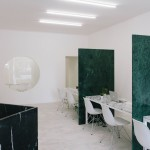 Fala Atelier adds green, grey and black marble inside Porto estate agents