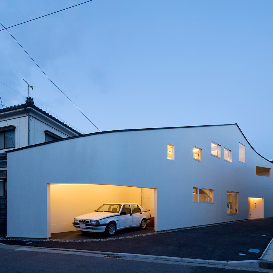 Roadside House by Naf Architect & Design has a driveway that doubles as a party space