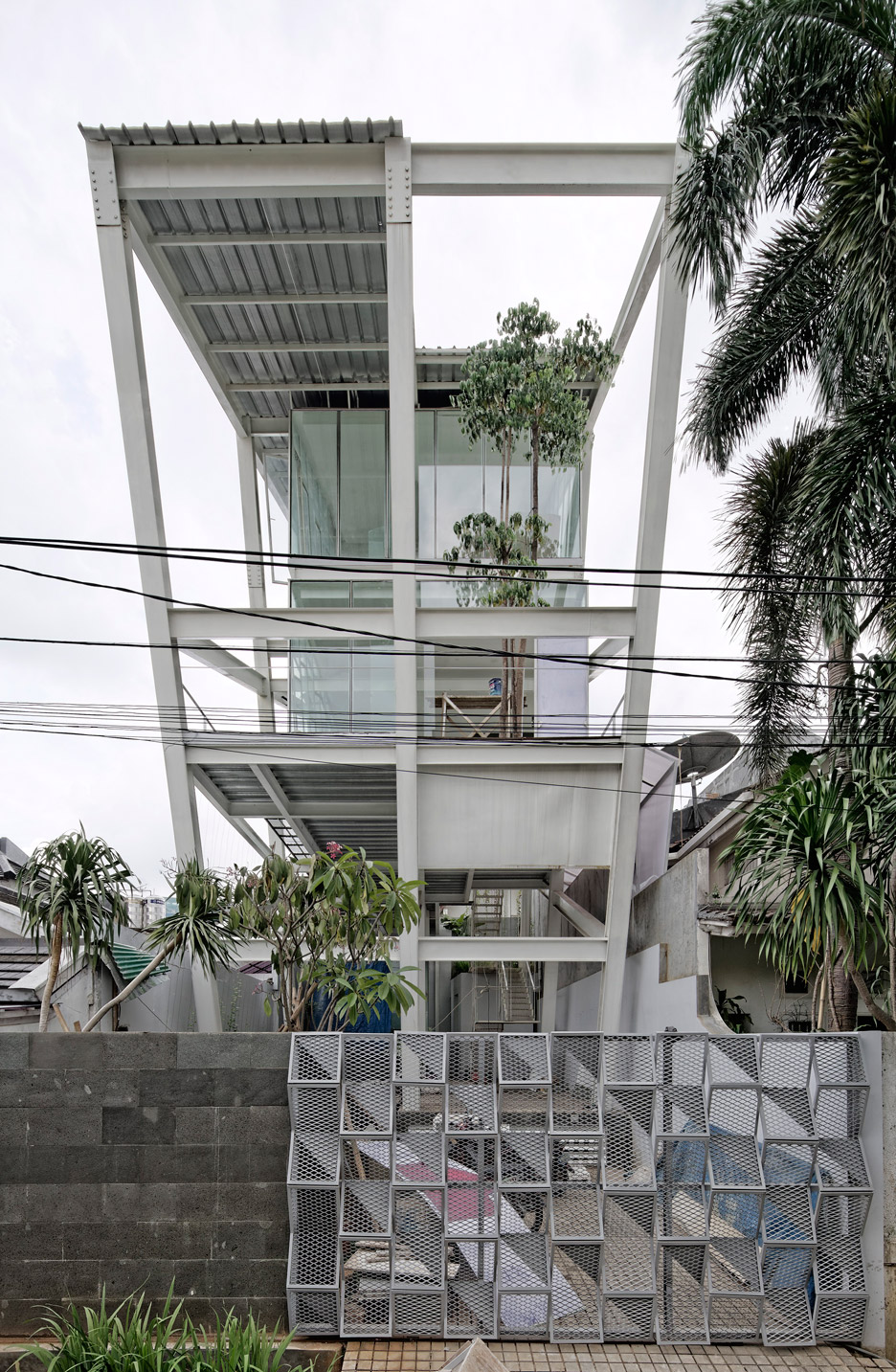 Rumah Miring by Budi Pradono Architects