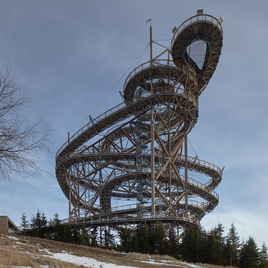 Fránek Architects' mountainside Sky Walk loops up around a giant slide