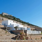 Kapsimalis Architects completes mountainside apartments near Santorini's highest point