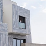 Strips of grey marble clad Granada residence by Ariasrecalde Taller de Arquitectura