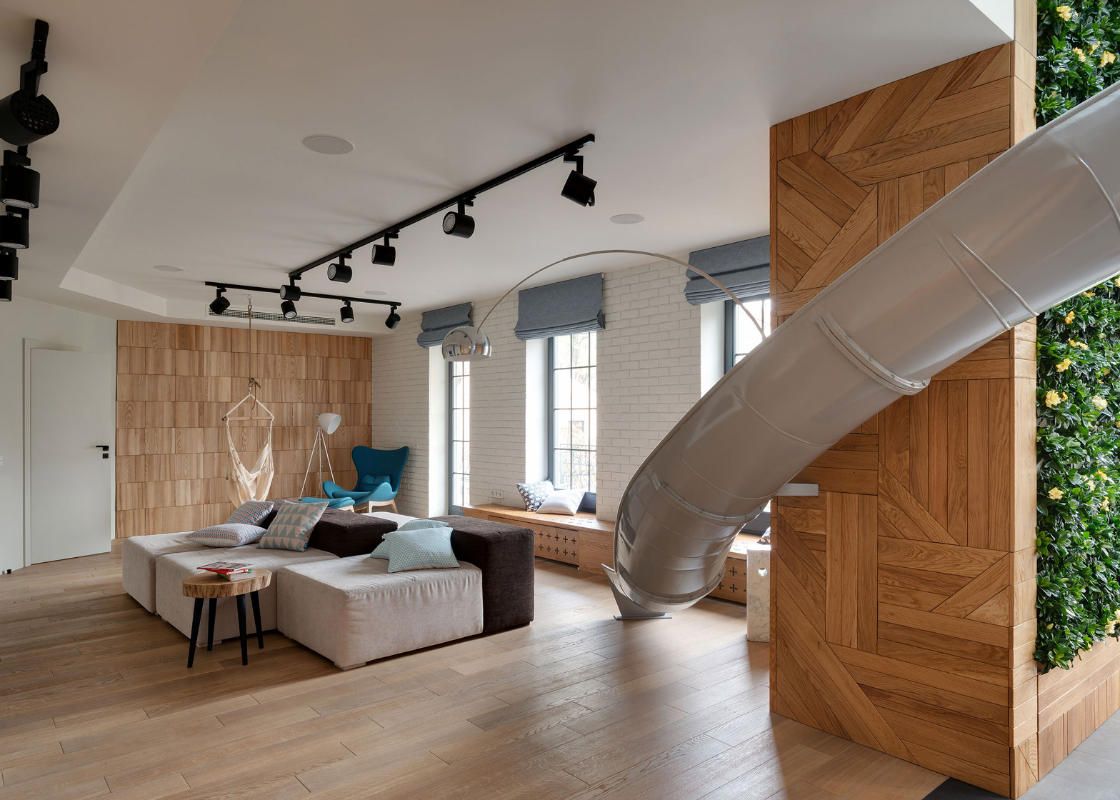 Apartment with a slide by KI Design Studio