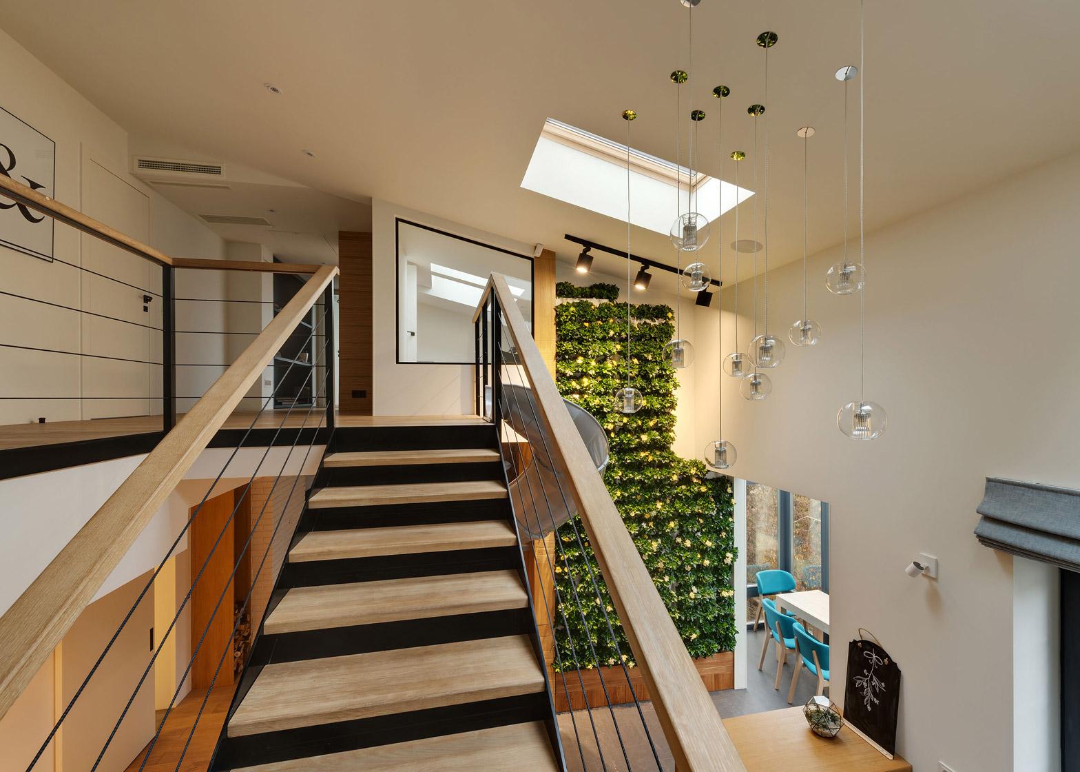 Apartment with a slide by KI Design Studio