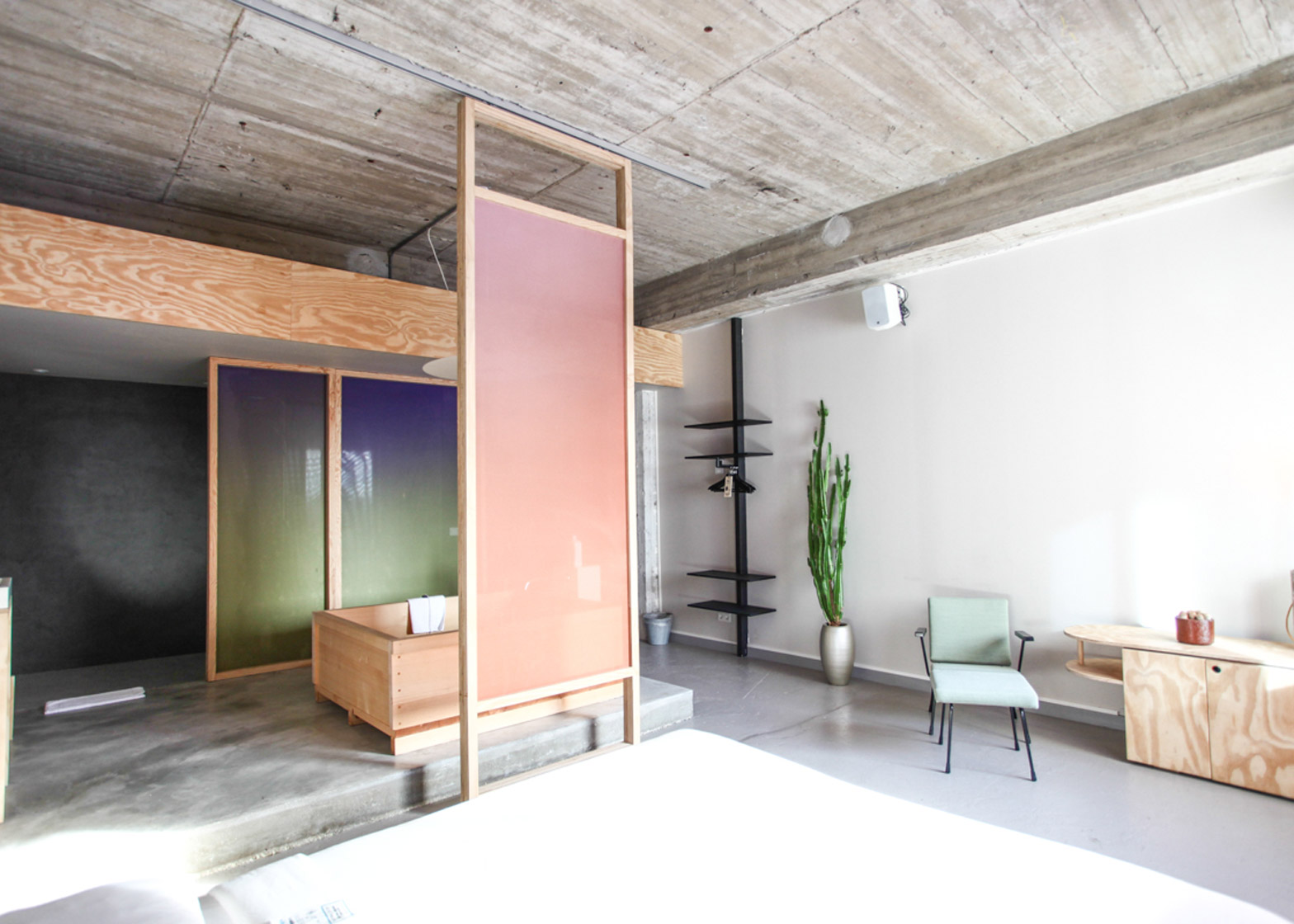Hanna Marings Volkshotel Suite Has A Wooden Bathtub And Colourful Screens