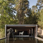 Stable built from railway sleepers tops El Mirador House in Mexico by CC Arquitectos