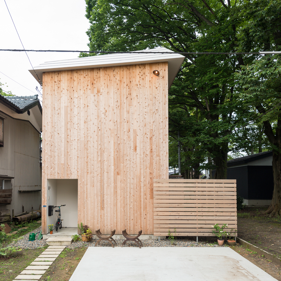 Compact wooden house by Takeru Shoji Architects stands alongside 200-year-old trees