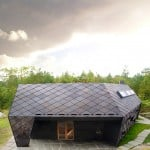 Dark grey slates create diamond-patterned facades for Cabin Ryfylke in Norway