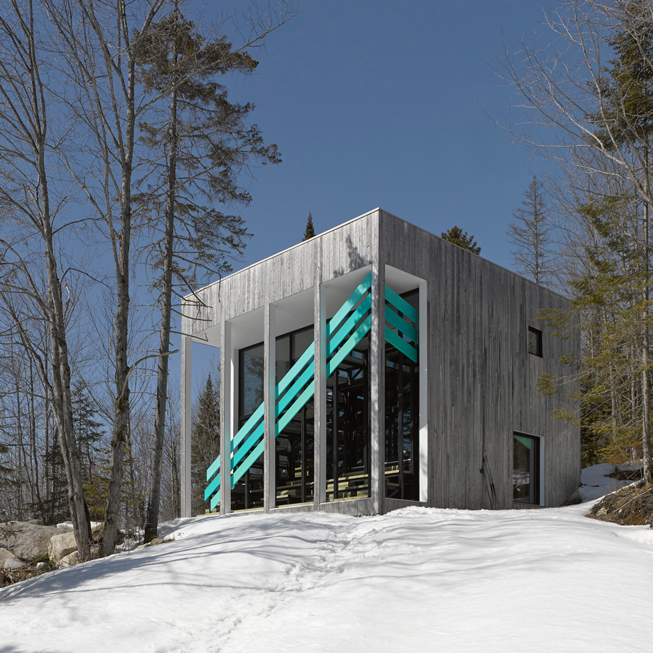 Turquoise staircase creates diagonal stripes across Quebec home by Architecturama
