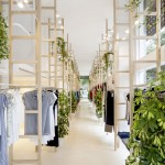 Clothes hang from wooden ladders in Mit Mat Mama store by Román Izquierdo Bouldstridge