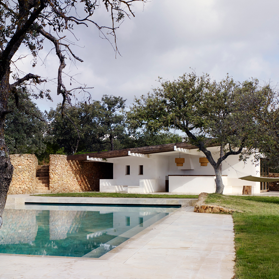 Roz Barr's pool house in the Sierra Nevada is surrounded by stone walls and olive trees