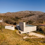 Concrete house with rooftop pool offers views over Portugal's Serra d'Arga mountains