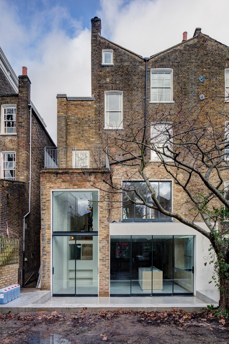 Apa creates warehouse inspired interior for refurbished for Townhouse architecture designs