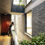 Mexican housing block by MMX features offset volumes and open corridors