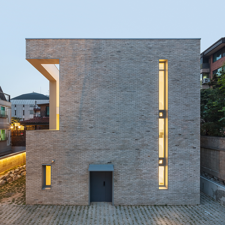 Deep-set windows maintain privacy for overlooked Gangnam residence by OBBA