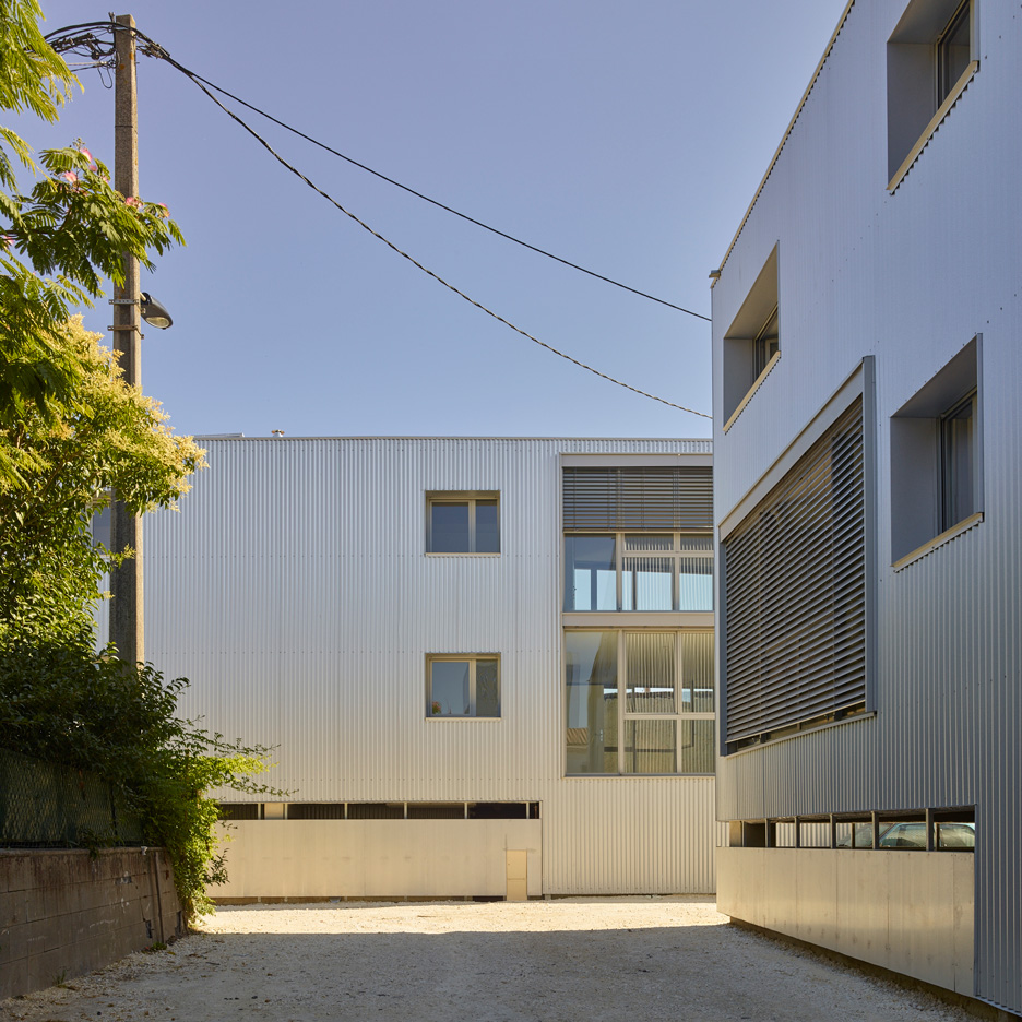 Fabre/deMarien's Tirepois apartments feature metal cladding and recessed windows
