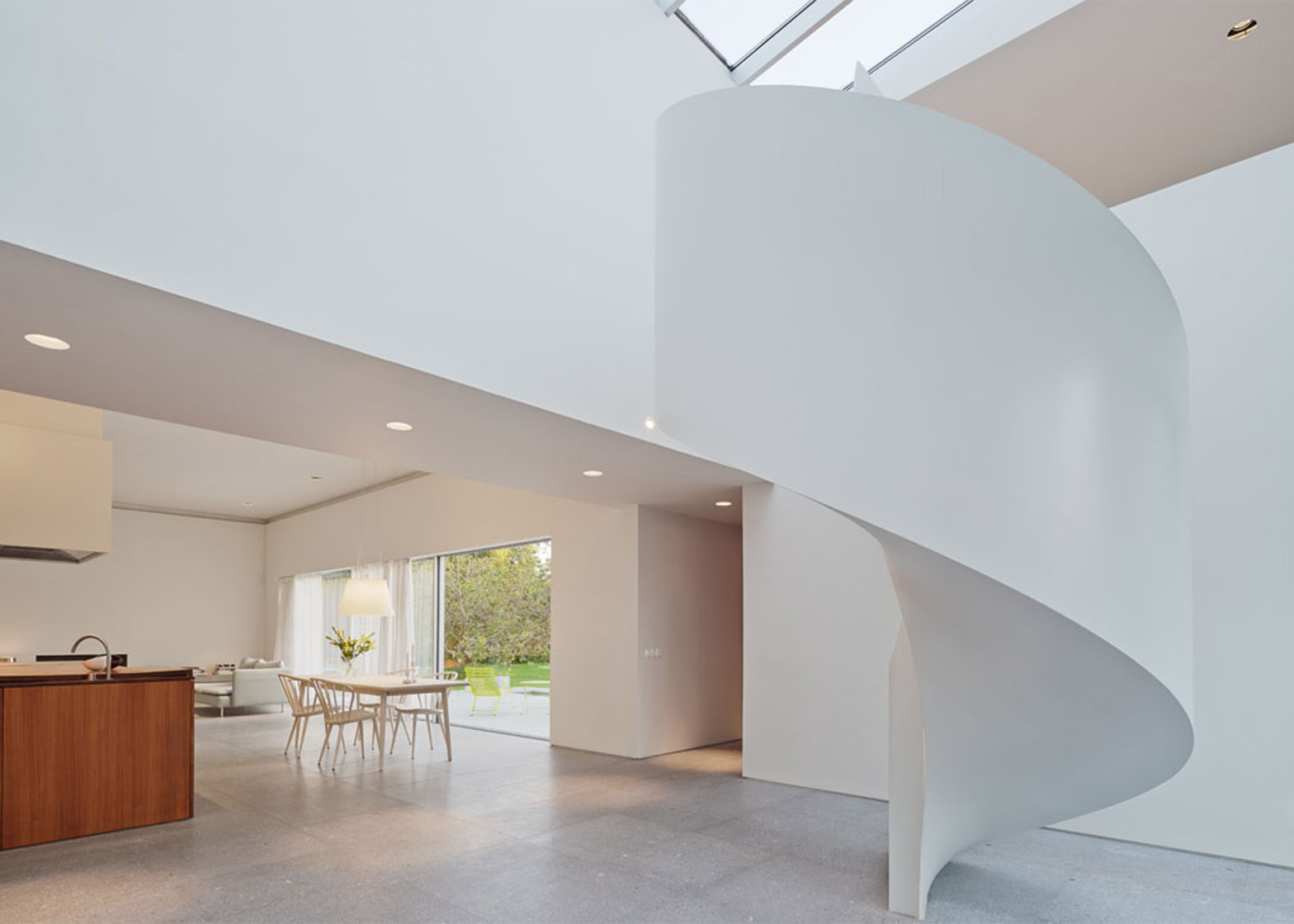 Sculptural staircase features in Swedish home by Jonas Lindvall