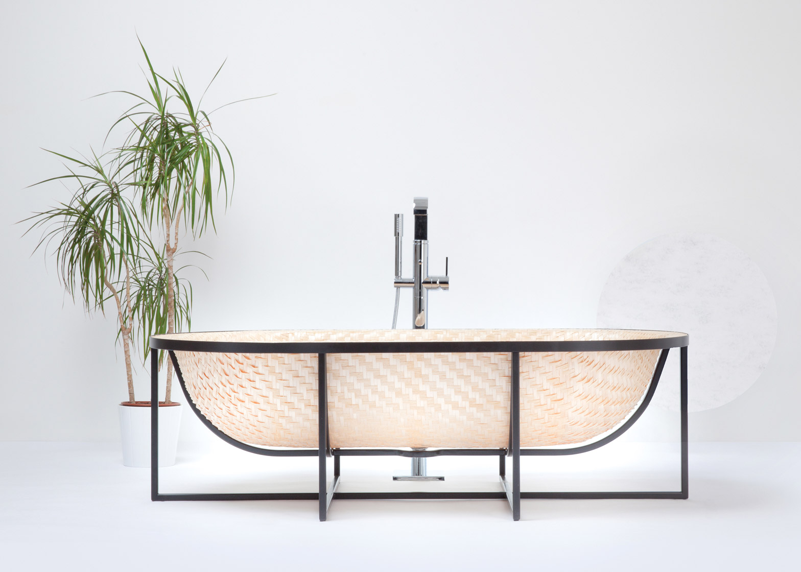 Tal Engel\'s Otaku bathtub is woven from wood