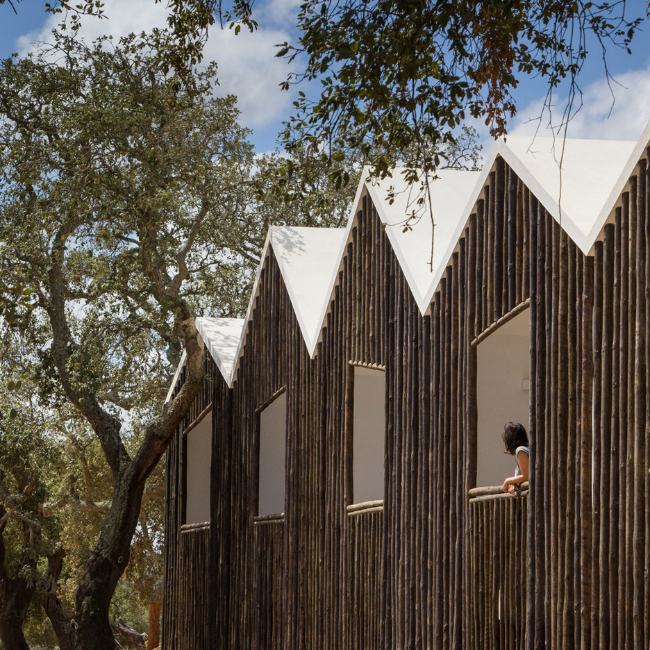 Alentejo Country Hotel features log facades to match the surrounding cork trees