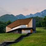Corrugated copper villa by Camillo Botticini Architetto frames Alpine views