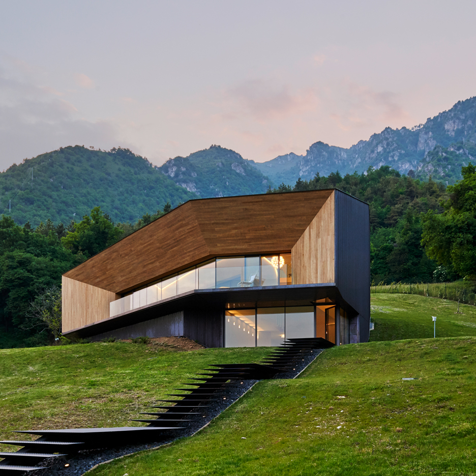 Corrugated copper villa by Camillo Botticini Architetto frames Alpine views