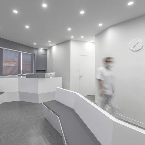 Ayeneh Office creates angled walls and minimal interior for Iranian dental clinic